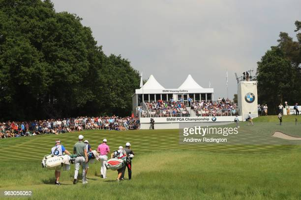 Ross Fisher of England Rory McIlroy of Northern Ireland and Francesco Molinari of Italy walk to the 14th green during the final round of the BMW PGA...
