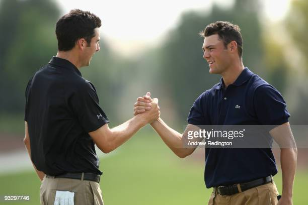 Ross Fisher of England shakes hands with Martin Kaymer of Germany on the 18th green during the final round of the Dubai World Championship on the...