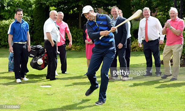 Ross Fisher of England trys his hand at Hurling during visit by Leixlip ambassador Ross Fisher prior to the Irish Open at Carton House Golf Club on...