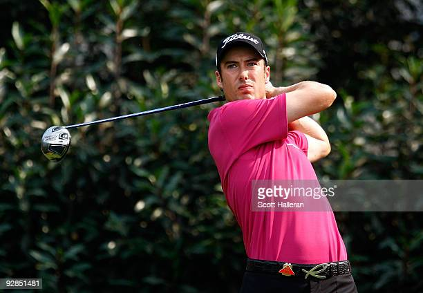Ross Fisher of England watches his tee shot on the fifth hole during the second round of the WGC-HSBC Champions at Sheshan International Golf Club on...
