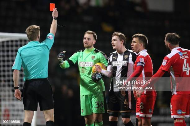 Ross Fitzsimons of Notts County is shown a red card by match referee Robert Lewis during the Sky Bet League Two match between Notts County and...