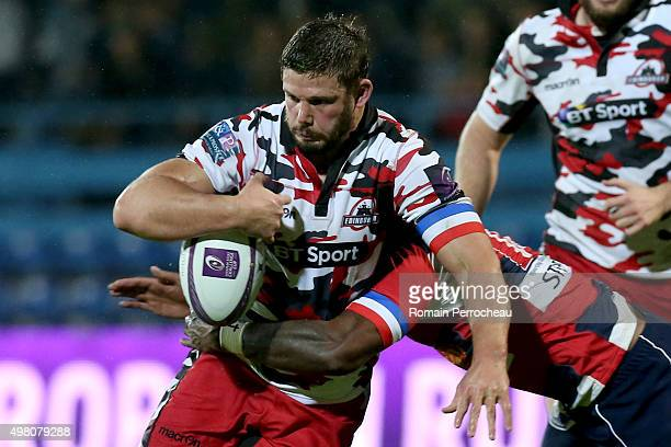 Ross Ford for Edimbourg is tackled by Filippo Nakosi during the European Rugby Challenge Cup match between Agen and Edimbourg at Stade Armandie on...