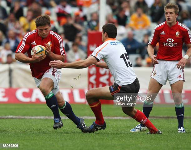 Ross Ford of the Lions takes on Hennie Daniller during the match between the Cheetahs and the British and Irish Lions on their 2009 tour of South...