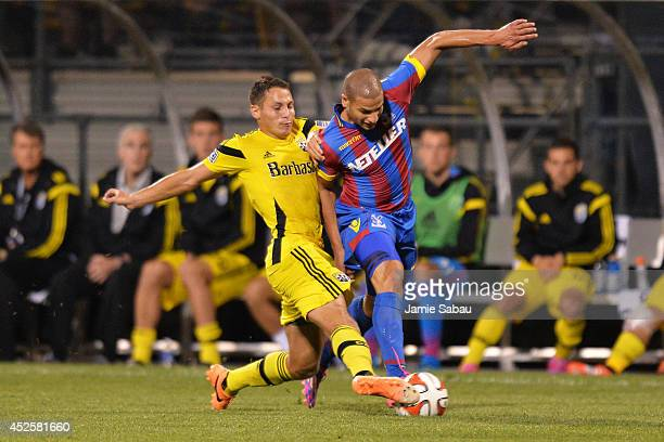 Ross Friedman of the Columbus Crew and Adlene Guedioura of Crystal Palace FC battle for control of the ball in the second half on July 23 2014 at...