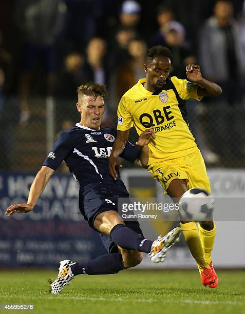 Ross Harvey of the Saints and Youssouf Hersi of the Glory compete for the ball during the FFA Cup match between St Albans Saints and Perth Glory at...