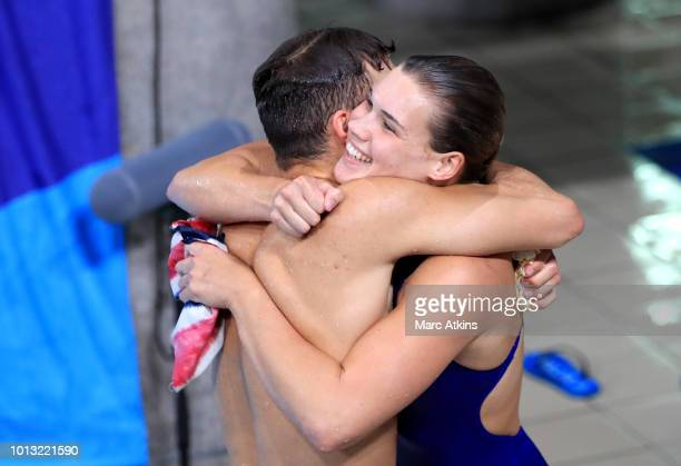 Ross Haslam and Grace Reid of Great Britain celebrate after winning Silver in the Mixed Synchronised 3m Springboard final during the diving on Day...