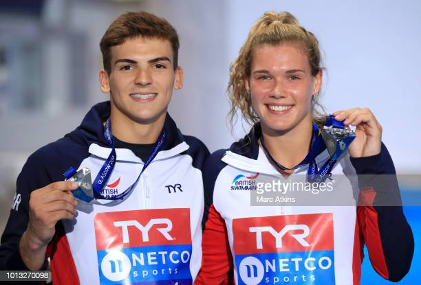 Ross Haslam and Grace Reid of Great Britain pose with their Silver medals after coming second in the Synchronised 3m Springboard Mixed Final during...