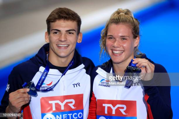 Ross Haslam and Grace Reid of Great Britain pose with their Silver Medals after the Mixed Synchronised 3m Springboard final during the diving on Day...
