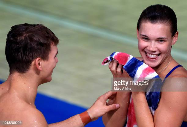 Ross Haslam and Grace Reid of Great Britain react after they compete in the Mixed Synchronised 3m Springboard final during the diving on Day seven of...
