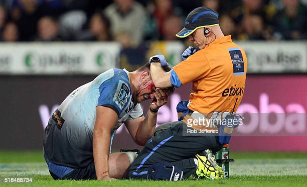 Ross HaylettPetty of the Western Force is treated for a head cut during the round six Super Rugby match between the Highlanders and the Western Force...