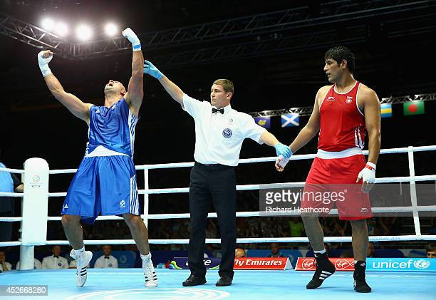 Ross Henderson of Scotland celebrates victory over Parveen Parveen Kumar of India in the Men's Super Heavy 91kg preliminaries at Scottish Exhibition...
