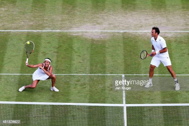 Ross Hutchins and Heather Watson of Great Britain during their Mixed Doubles first round match against Mikhail Elgin of Russia and Anastasia...