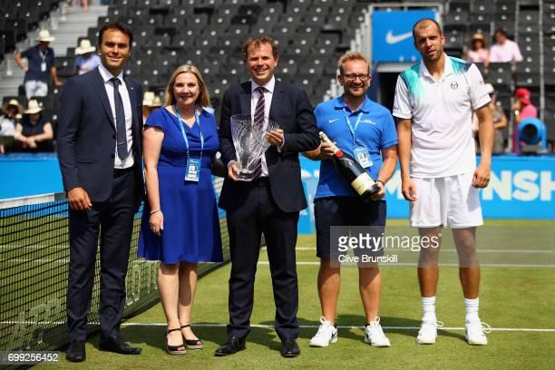 Ross Hutchins, former tennis player, title sponsor from Aegon, Tara McGregor, Tournament Director, Stephen Farrow, the Queen's Club's groundsman...