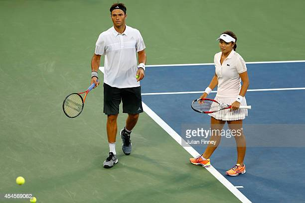 Ross Hutchins of Gret Britain and his partner Yung-Jan Chan of Taipei play against Sania Mirza of India and Bruno Soares of Brazil during their mixed...