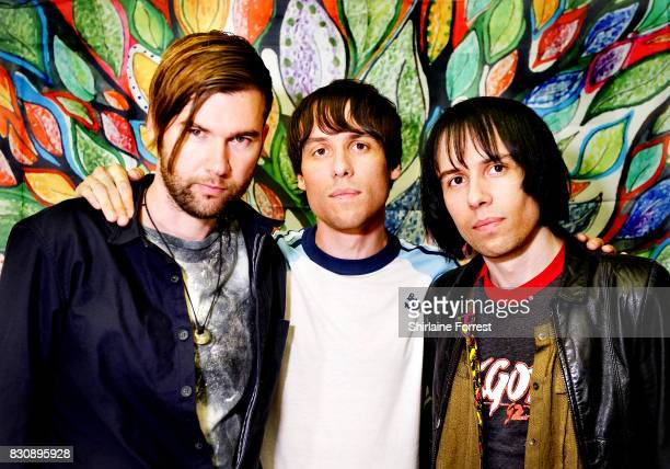 Ross Jarman Gary Jarman and Ryan Jarman of the Cribs pose backstage after performing live and signing copies of their new album '247 Rock Star Shit'...