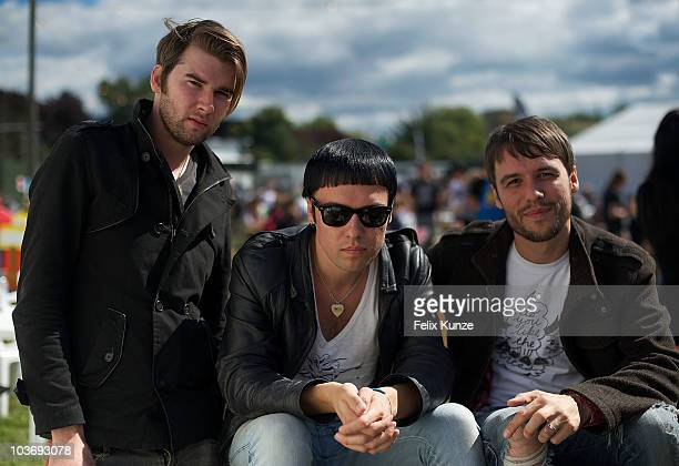 Ross Jarman Ryan Jarman and Gary Jarman of English rockband The Cribs relax backstage on day two of the Reading Festival at Richfield Avenue on...