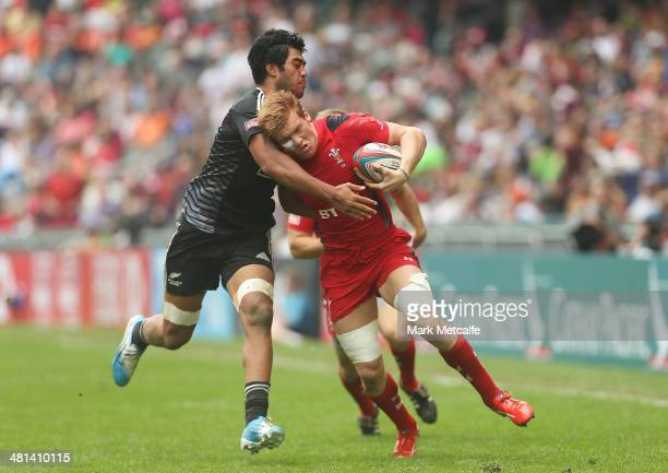 Ross Jones of Wales is tackled during the Cup quarterfinal match between Wales and New Zealand during day three of the 2014 Hong Kong Sevens at Hong...