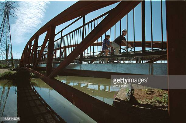 Ross July 27 2001 Olivia Chow and Jack Layton will ride on a tandem bicycle at a new bridge across the Don River at foot of DVP at Don Roadway JIM...