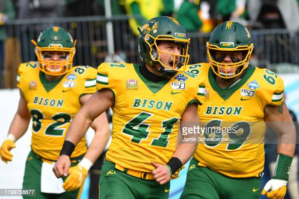 Ross Kennelly of the North Dakota State Bison celebrates after his tackle against punt returner D'Angelo Amos of the James Madison Dukes during the...