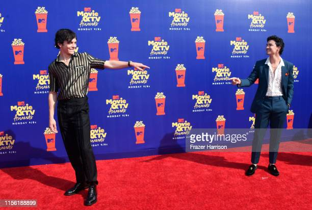 Ross Lynch and Gavin Leatherwood attend the 2019 MTV Movie and TV Awards at Barker Hangar on June 15 2019 in Santa Monica California
