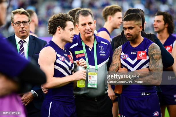 Ross Lyon coach of the Dockers talks with Lachie Neale and Bradley Hill after the loss during the 2018 AFL round 23 match between the Fremantle...
