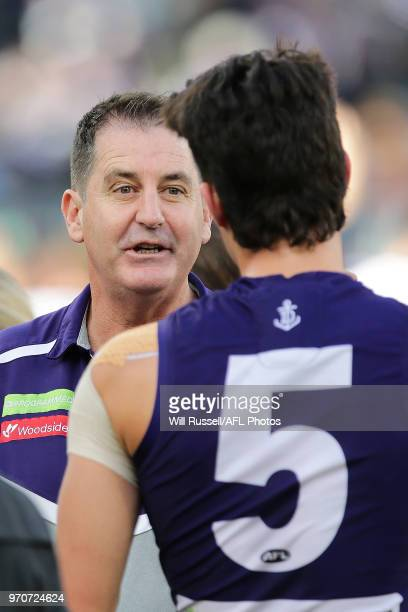 Ross Lyon Senior Coach of the Dockers addresses the players at the quarter time break during the round 12 AFL match between the Fremantle Dockers and...