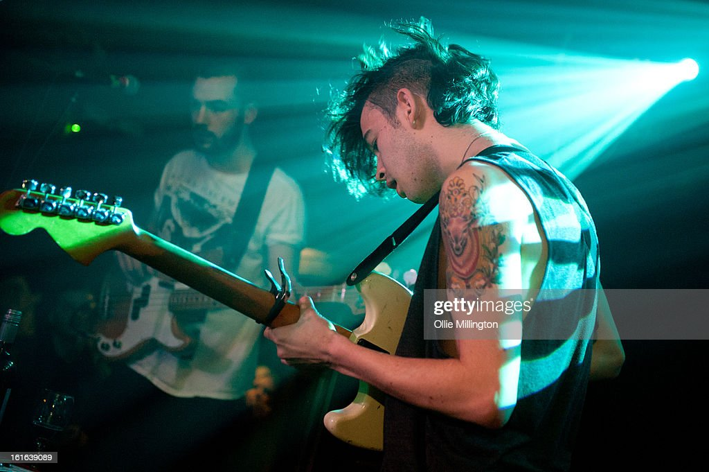 Ross MacDonald and Matthew Healy of The 1975 perform on stage at The Bodega Social Club on February 13, 2013 in Nottingham, England.