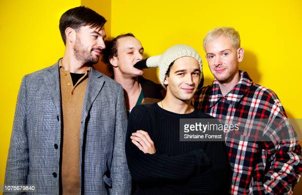 Ross MacDonald George Daniel Matthew Healy and Adam Hann of The 1975 pose backstage after meeting fans and signing copies of their new album 'A Brief...