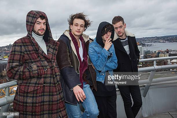 Ross MacDonald George Daniel Matthew Healy and Adam Hann of The 1975 pose for a photo after a 'Love Me' listening party hosted by 1077 The End at the...