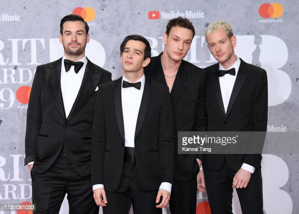 Ross MacDonald Matthew Healy George Daniel and Adam Hann of The 1975 attend The BRIT Awards 2019 held at The O2 Arena on February 20 2019 in London...