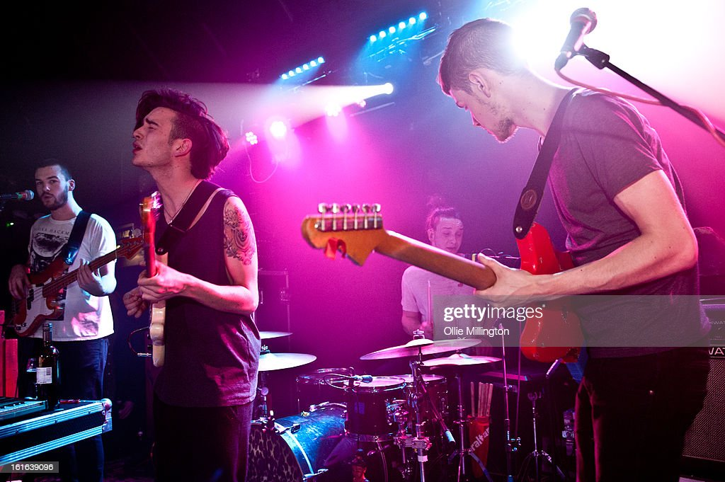 Ross MacDonald, Matthew Healy, George Daniel and Adam Hann of The 1975 perform on stage at The Bodega Social Club on February 13, 2013 in Nottingham, England.