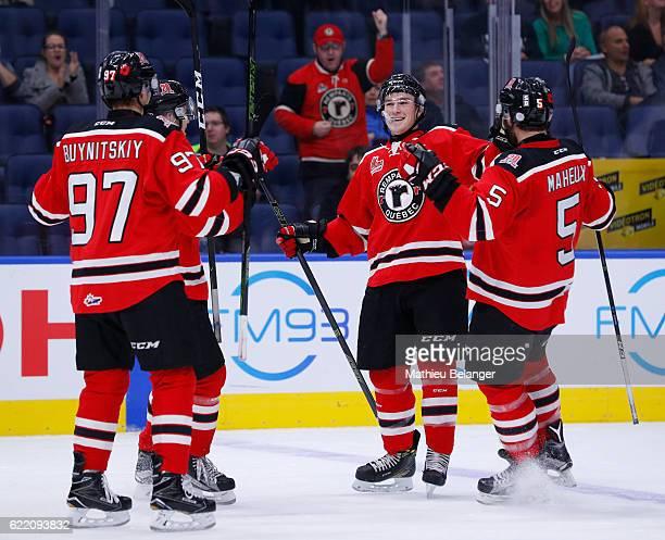 Ross MacDougall, Dmitry Buynitskiy, Philipp Karashev and Raphael Maheux celebrate a goal against the Acadie-Bathurst Titan during their QMJHL hockey...