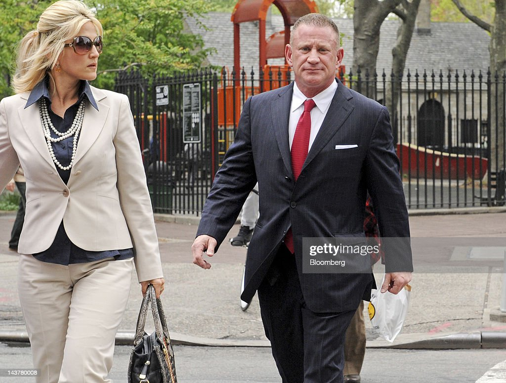 Ross Mandell, former chief executive officer and founder of Sky Capital Holdings Ltd., right, enters federal court for sentencing in New York, U.S., on Thursday, May 3, 2012. Mandell is being sentenced on charges related to a scheme to defraud investors through two successive securities broker-dealers and faces up to 65 years in prison and more than $5 million in fines. Photographer: Louis Lanzano/Bloomberg via Getty Images