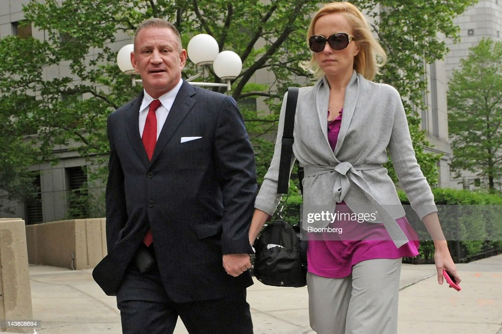 Ross Mandell, former chief executive officer and founder of Sky Capital Holdings Ltd., left, exits federal court with his wife Stephanie Mandell in New York, U.S., on Thursday, May 3, 2012. Mandell was sentenced to 12 years in prison for operating what prosecutors alleged was an eight-year scheme that defrauded investors of $140 million. Photographer: Louis Lanzano/Bloomberg via Getty Images