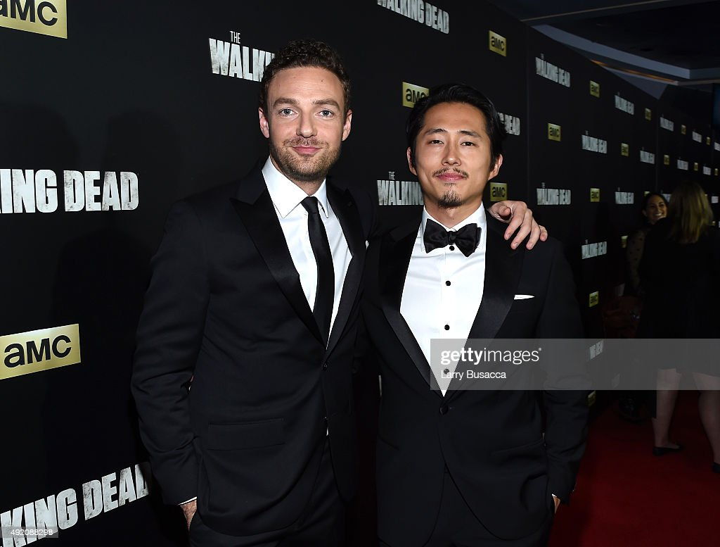 Ross Marquand and Steven Yeun attend AMC's 'The Walking Dead' Season 6 Fan Premiere Event 2015 at Madison Square Garden on October 9, 2015 in New York City.