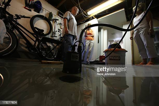 TORONTO ON JULY 10 Ross Marsden pumps the basement of his son's home They are lucky to have power but the water won't go awayRoyal York and Bloor...
