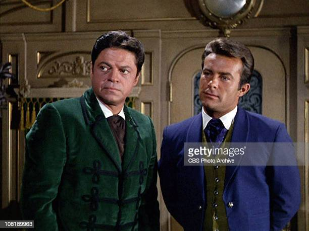 Ross Martin as Artemus Gordon and Robert Conrad as James T West in The Night of the Eccentrics season 2 episode 1 of THE WILD WILD WEST Airdate...
