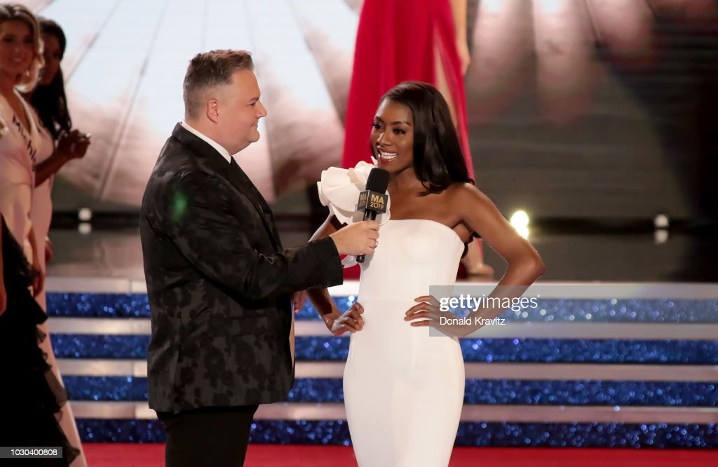 Ross Mathews asks a question of Nia Franklin, Miss America, 2019 during the Evening wear portion at the Miss America 2019 Finals at Atlantic City Boardwalk Hall on September 9, 2018 in Atlantic City, New Jersey.