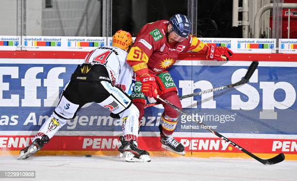 Ross Mauermann of the Fischtown Pinguins and Marc Zanetti of the Duesseldorfer EG during the game between the Duesseldorfer EG and the Fischtown...