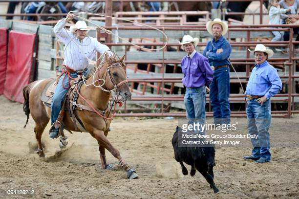 Ross McAdow chases down a calf during the tie-down roping event, Sunday, Aug. 4 at the Boulder County Fair in Longmont. The CPRA rodeo featured nine...