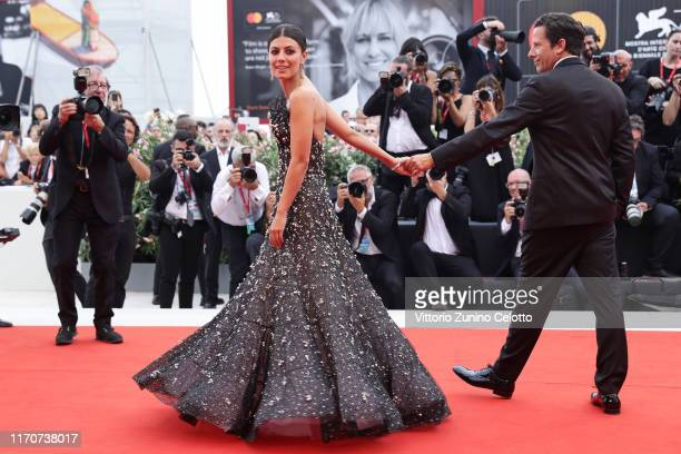 Ross McCall and Festival hostess Alessandra Mastronardi walk the red carpet ahead of the Opening Ceremony and the La Vérité screening during the 76th...