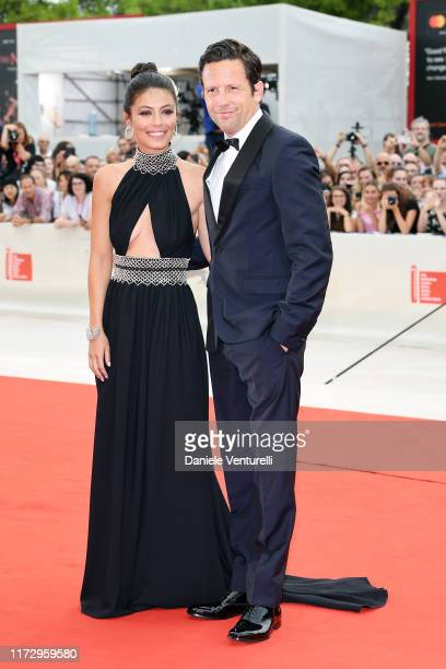 Ross McCall and Festival Hostess Alessandra Mastronardi walk the red carpet ahead of the closing ceremony of the 76th Venice Film Festival at Sala...