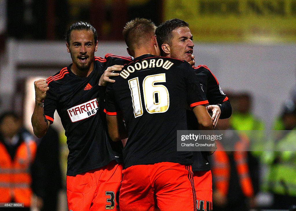 Ross McCormack of Fulham celebrates with team mates after scoring the first goal of the game during the Capital One Cup Second Round match between Brentford and Fulham at Griffin Park on August 26, 2014 in London, England.