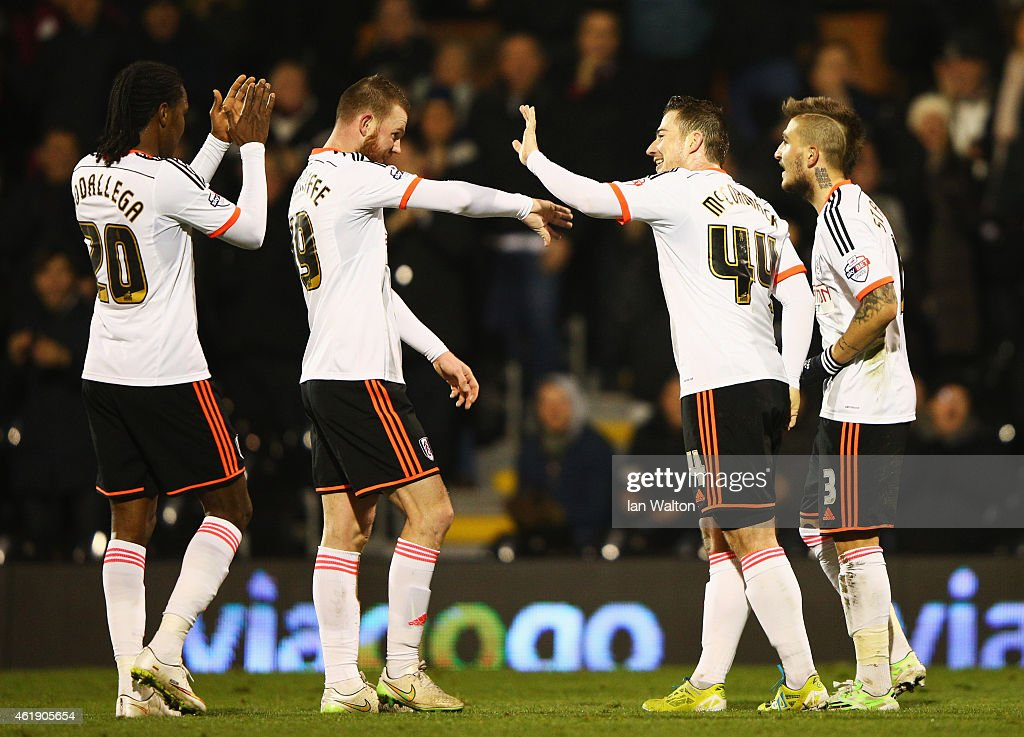Ross McCormack of Fulham (2R) celebrates with team mates Hugo Rodallega (20), Ryan Tunnicliffe (19) and Kostas Stafylidis (3) as he scores their third goal and completes his hat trick during the Sky Bet Championship match between Fulham and Nottingham Forest at Craven Cottage on January 21, 2015 in London, England.