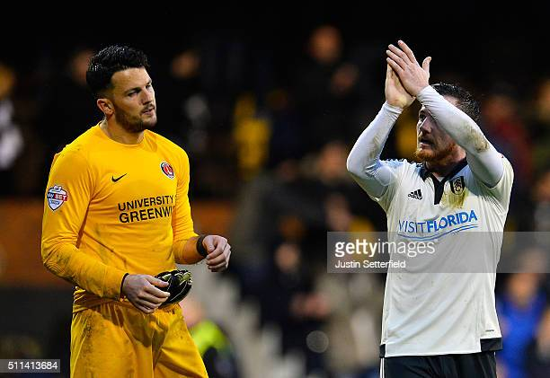 Ross McCormack of Fulham FC claps the home fans as Stephen Henderson of Charlton FC looks dejected after the Sky Bet Championship match between...