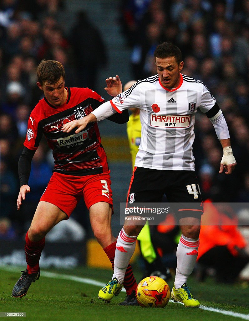 Ross McCormack (R) of Fulham holds off the challenge of Paul Dixon (L) of Huddersfield Town during the Sky Bet Championship match between Fulham and Huddersfield Town at Craven Cottage on November 8, 2014 in London, England.
