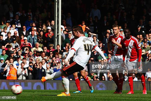 Ross McCormack of Fulham scores his sides second goal from the penalty spot during the Sky Bet Championship match between Fulham and Middlesbrough at...