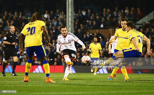 Ross McCormack of Fulham shoots past the Wigan Athletic defence to score their first goal during the Sky Bet Championship match between Fulham and...