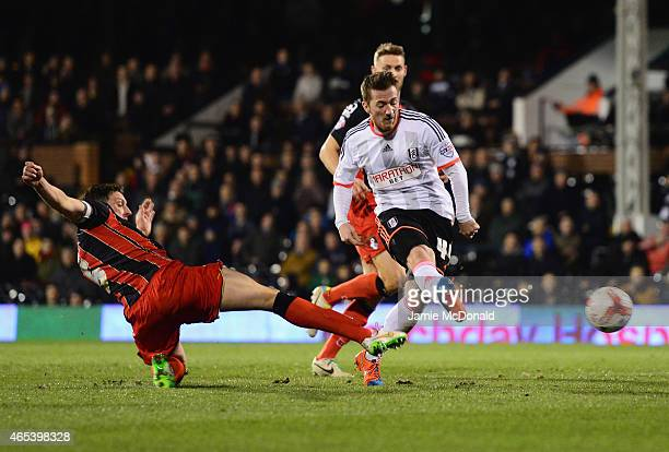 Ross McCormack of Fulham shoots past Tommy Elphick of Bournemouth during the Sky Bet Championship match between Fulham and AFC Bournemouth at Craven...