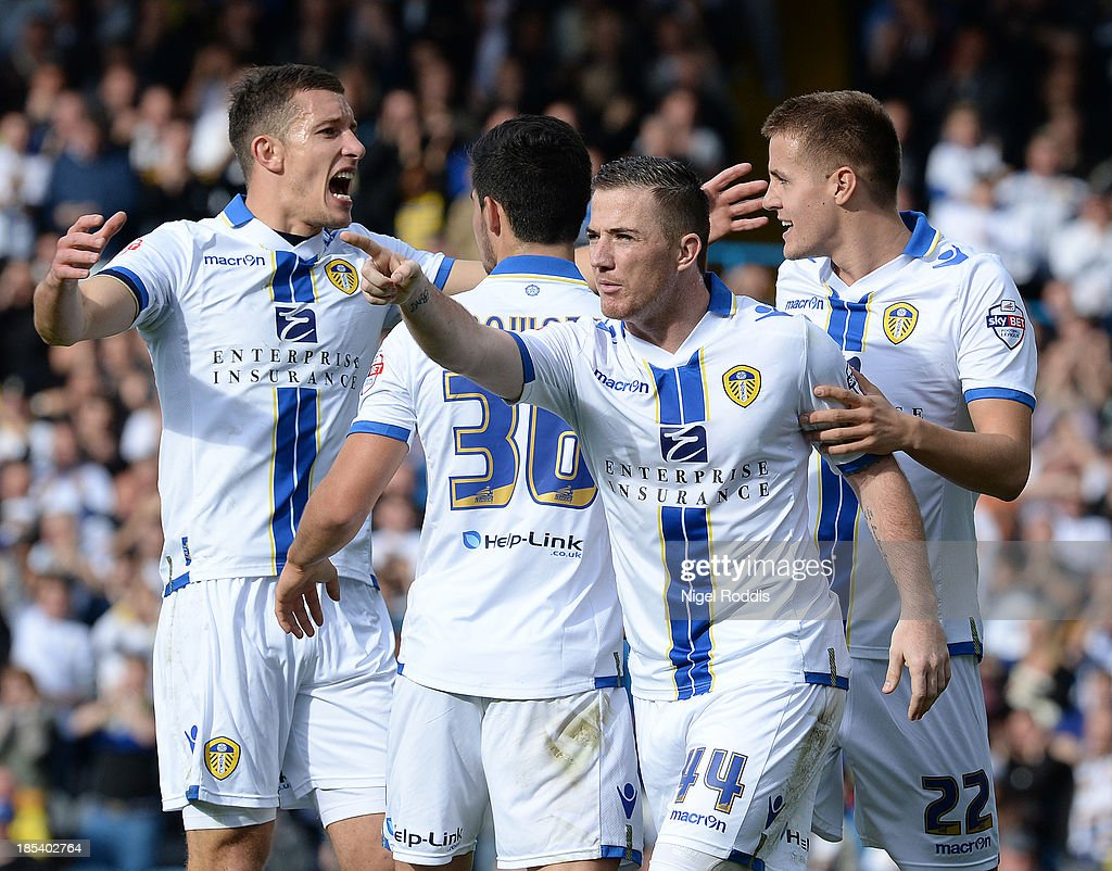 Ross McCormack (2ndR) of Leeds United celebrates scoring during their Sky Bet Championship match between Leeds United and Birmingham City at Elland Road Stadium on October 20, 2013 in Leeds, England.